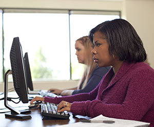 Adult Degree Program student on computer