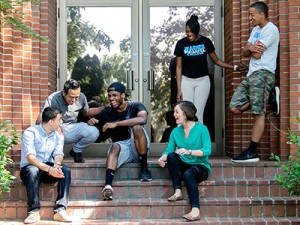 Warner Pacific students sharing a laugh together on the steps of A.F. Gray.
