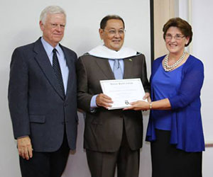 Dr. Cook (right) with Dr. Christensen and KAFU President, Dr. Mambetkaziyev