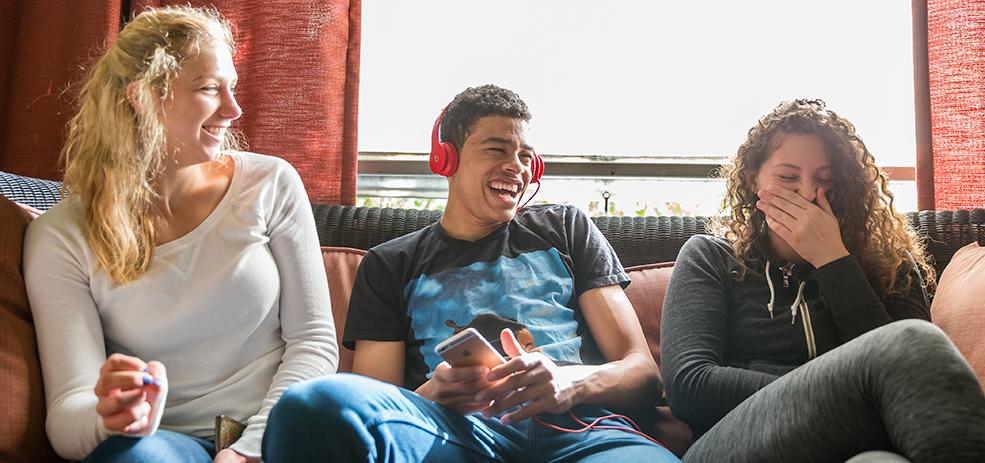 Warner Paciifc students sharing and laughing at a joke