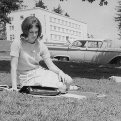 WPC historical photo of a student studying on the lawn.