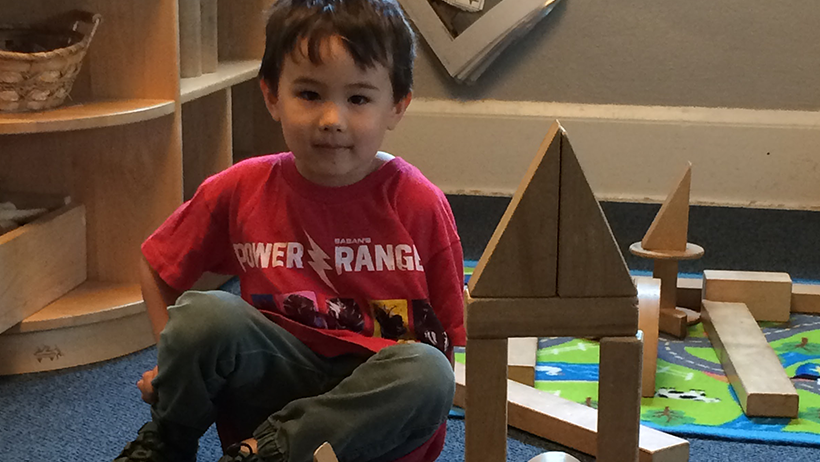 boy with block tower in Early Learning Center