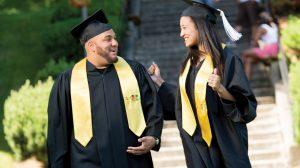 Two graduates walking outside