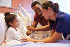 Nurse serving a young patient in a hospital